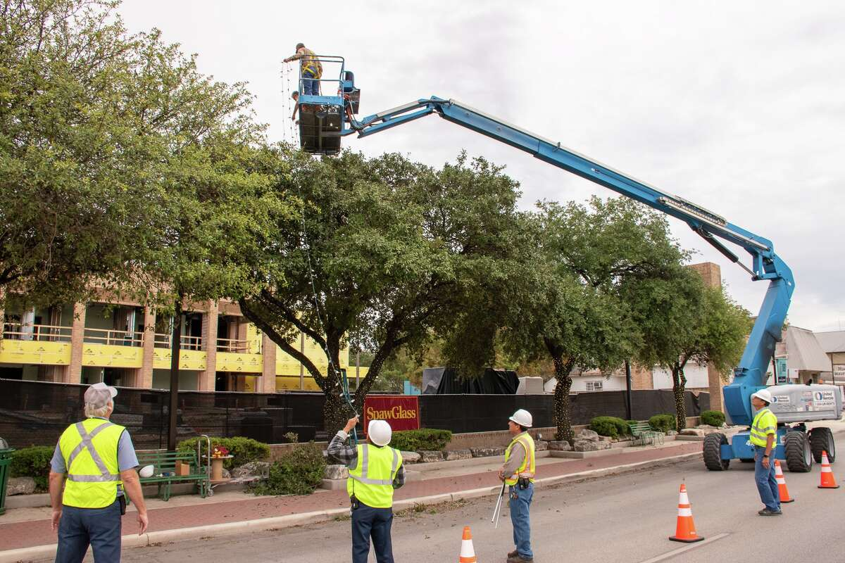 Comal County facilities maintenance crews began the task of hanging up Christmas lights around the Comal County Courthouse and in the various trees in downtown on Oct. 17. Officials cited a busy social calendar for the city as the reason for the early start.