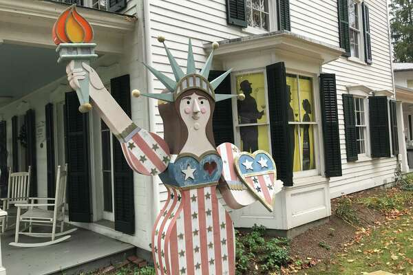 A small replica of the Statue of Liberty in front of the Westport Museum for History and Culture. Taken Oct 8, 2019 in Westport, Conn.