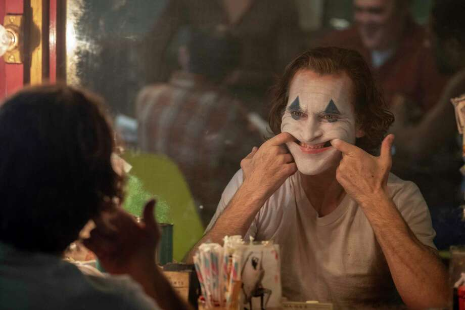"This image released by Warner Bros. Pictures shows Joaquin Phoenix in a scene from the film ""Joker."" Photo: Niko Tavernise / Associated Press / © 2018 Warner Bros. Entertainment Inc. All Rights Reserved"