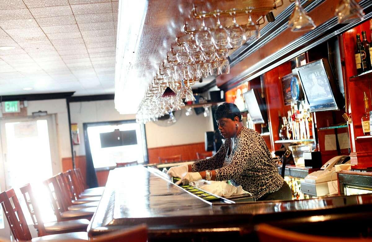 Bartender Denise Tucker gets ready to open at Sam Jordan's Bar in San Francisco, Calif., Monday, January 21, 2013. The bar recently obtained landmark status.