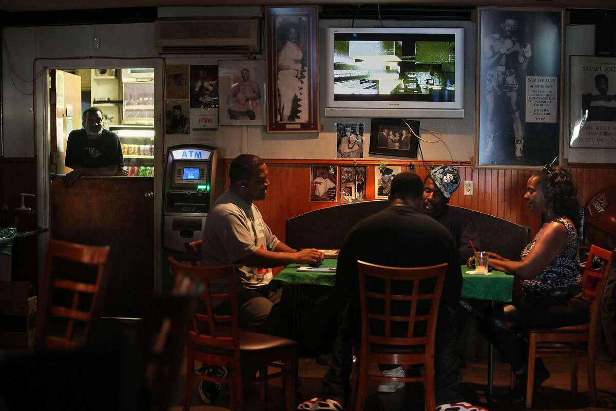 Domino is a favorite table game at Sam Jordan's House of Ribs, 4004 3rd St., in San Francisco, California, on Tuesday,