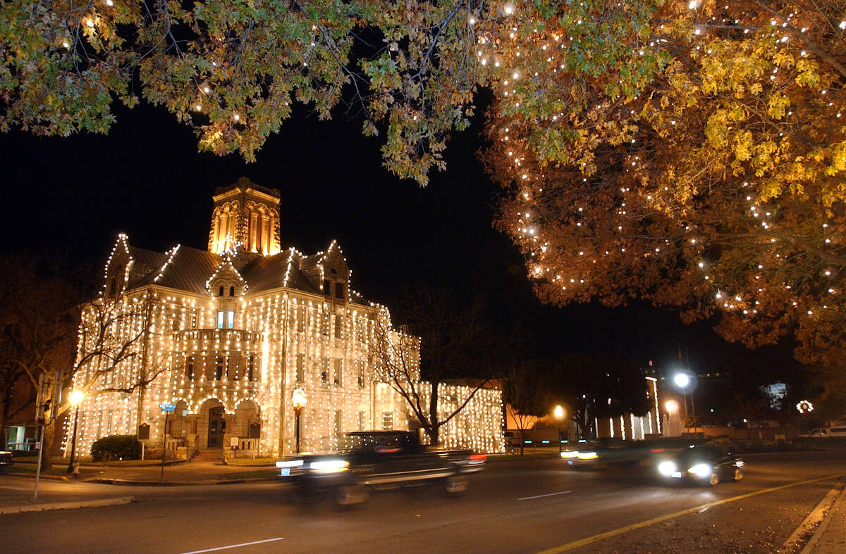 The Comal County courthouse on town square in New Braunfels shines with Christmas lighting complimented by decorations across the street in the gazebo area. Tom Reel/Staff December 10, 2002.