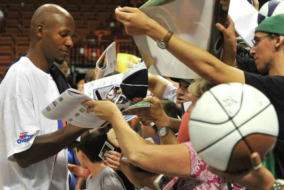 Boston Celtics' Ray Allen, left, signs autographs after the Jim Calhoun Celebrity Classic charity All-Star basketball game in Uncasville, Conn., on Saturday, Aug. 7, 2010. (AP Photo/Jessica Hill) Photo: AP