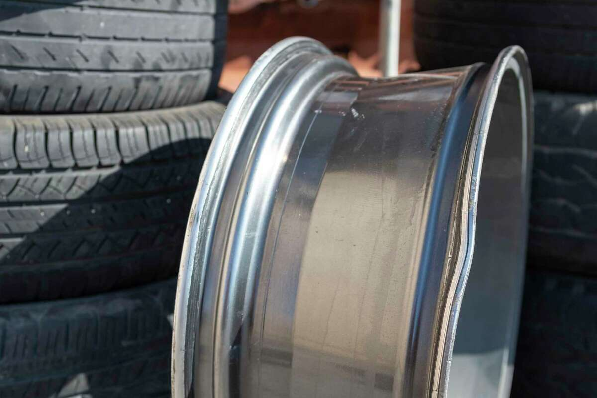 A discarded damaged rim is shown outside of the Discount Tire on T C Jester on Oct 7, 2019, in Houston.