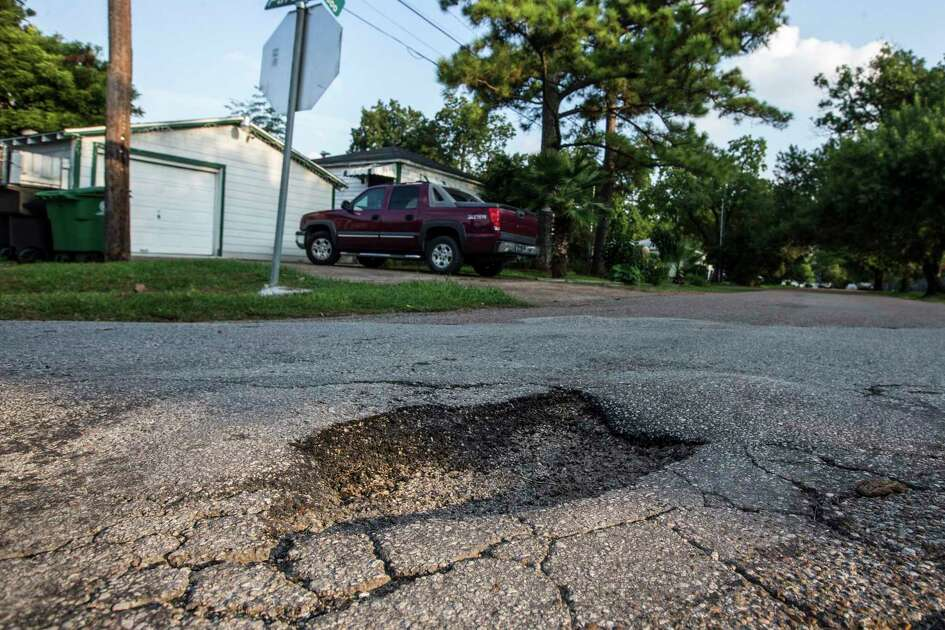 A large pothole and a section of broken asphalt near Coral and Parson is shown in need of repair on Aug. 26, 2019, in Houston. Both streets scored less than a 50 on a 0-100 scale during a pavement assessment in March 2018.