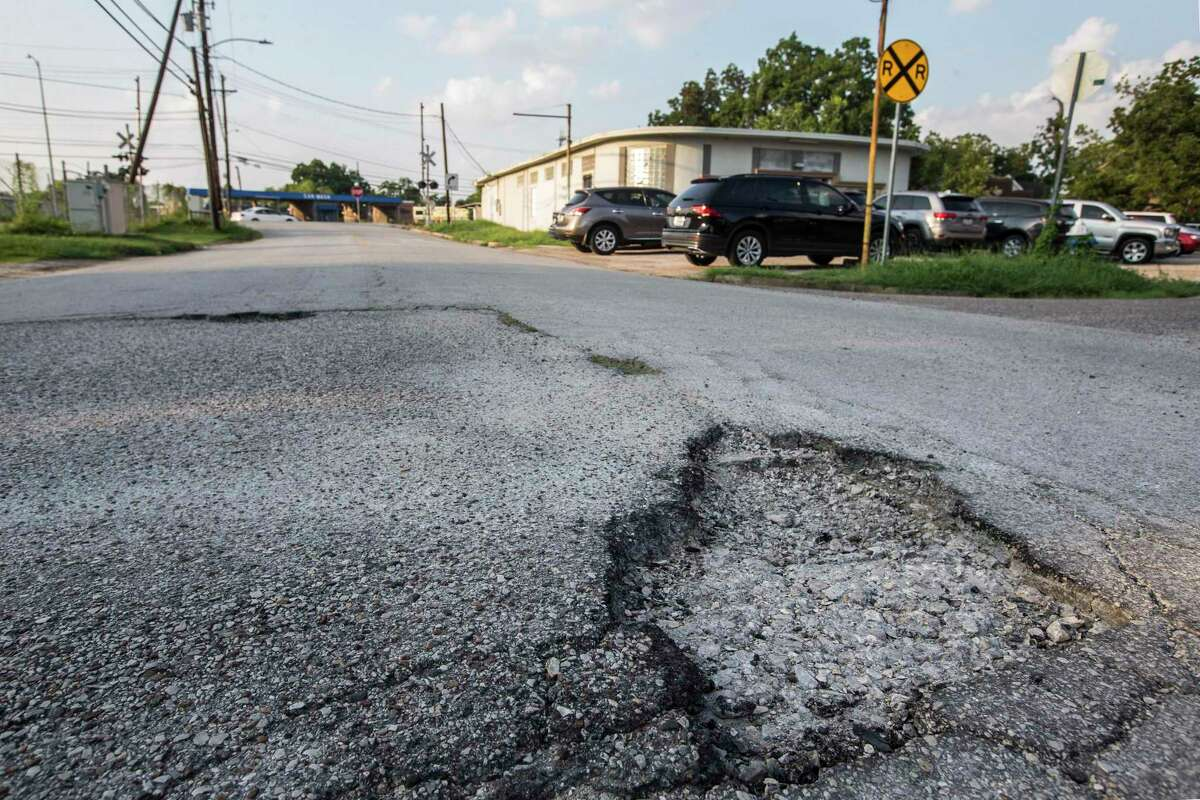 A large pothole and a section of broken asphalt near Redwood and Myrtle is shown in need of repair on Aug. 26, 2019, in Houston. Redwood is among the worst streets in the city according to a 2018 assessment.
