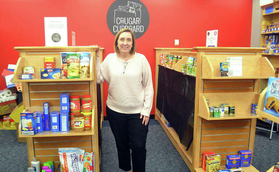 Carolyn Compton, assistant director of community engagement for Kimmel Student Involvement Center at SIUE, stands inside the Cougar Cupboard food pantry, located on the second floor of the Morris University Center. The pantry offers food items and hygiene care products to eligible students, faculty and staff with a valid SIUE ID. Photo: Scott Marion | The Intelligencer