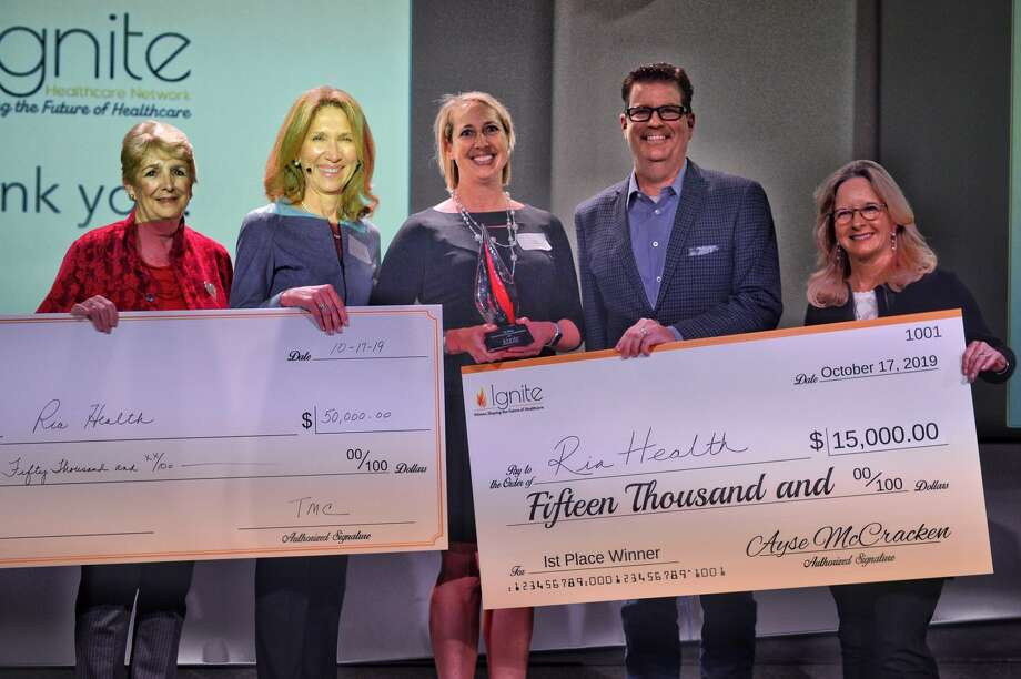 Jen Douglas, chief financial officer of Ria Health, center, won first place at the Fire Pitch Competition hosted by Ignite Healthcare Network on Thursday, Oct. 17, 2019. She received a $15,000 cash prize from Ignite Healthcare Network and a $50,000 investment prize from the Texas Medical Center Innovation Institute. Photo: Ignite Healthcare Network / Don Lawrence