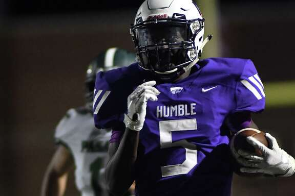 Humble junior wide receiver Robert Williams III (5) breaks away from a Pasadena defender on his touchdown catch in the 3rd quarter of their District 22-6A matchup at Turner Stadium in Humble on Oct. 17, 2019.