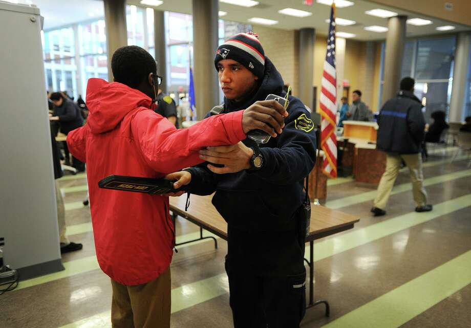 A school security officer wands a student  at the start of the school day in Connecticut in 2015. A reader says it's time for Texas schools to install metal detectors. Photo: File Photo / Connecticut Post
