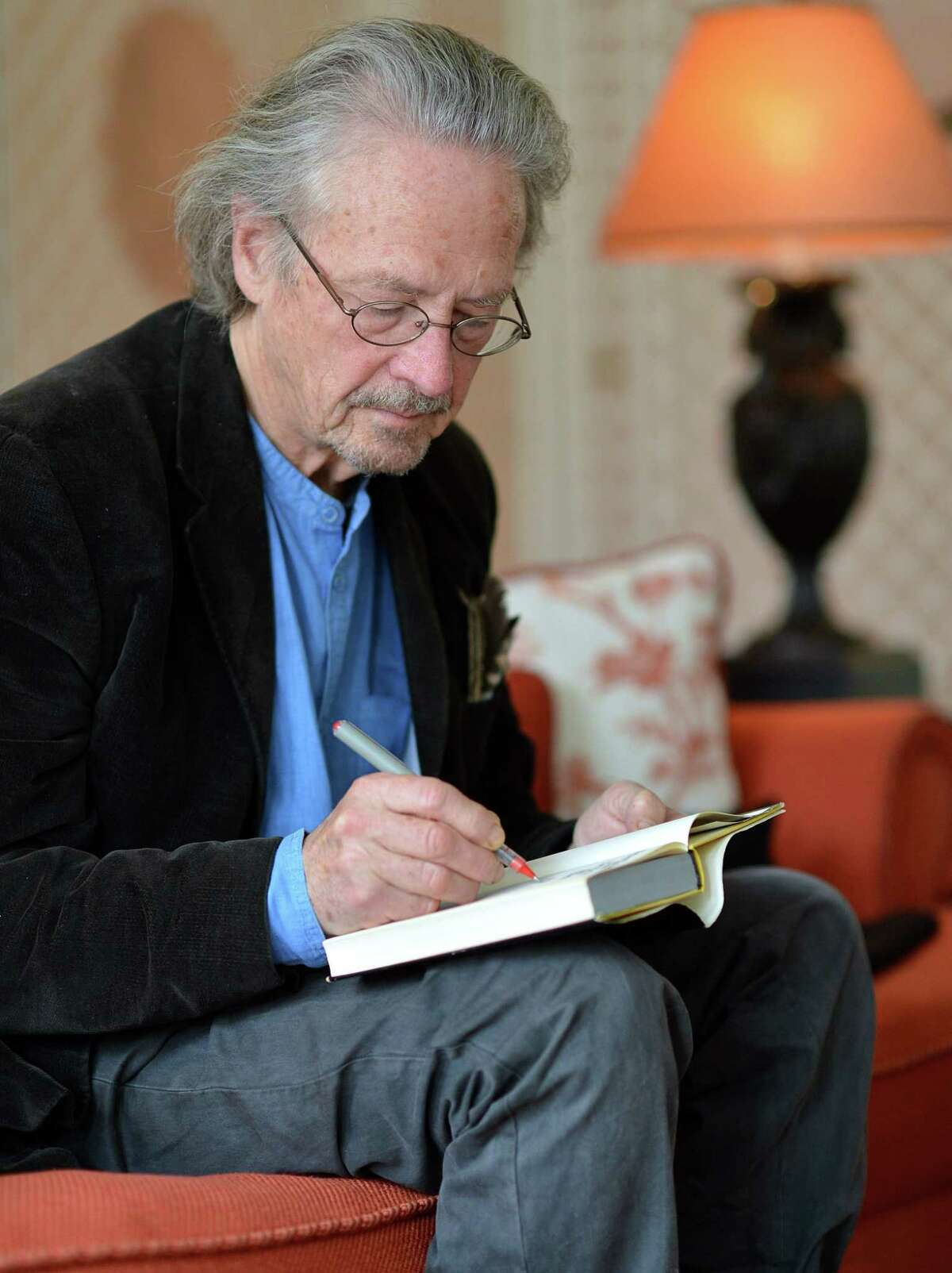 """Austrian novelist and playwright Peter Handke, pictured here in 2012, was awarded the Nobel Literature Prize on Oct. 10, but he became politically notorious in the 1990s for defending Serbia's conduct during the Balkan wars. In 2006, he eulogized Slobodan Milosevic, the Serbian dictator principally responsible. Asked about the corpses of Muslims massacred in Srebrenica in 1995, Handke replied, """"You can stick your corpses up your arse."""""""