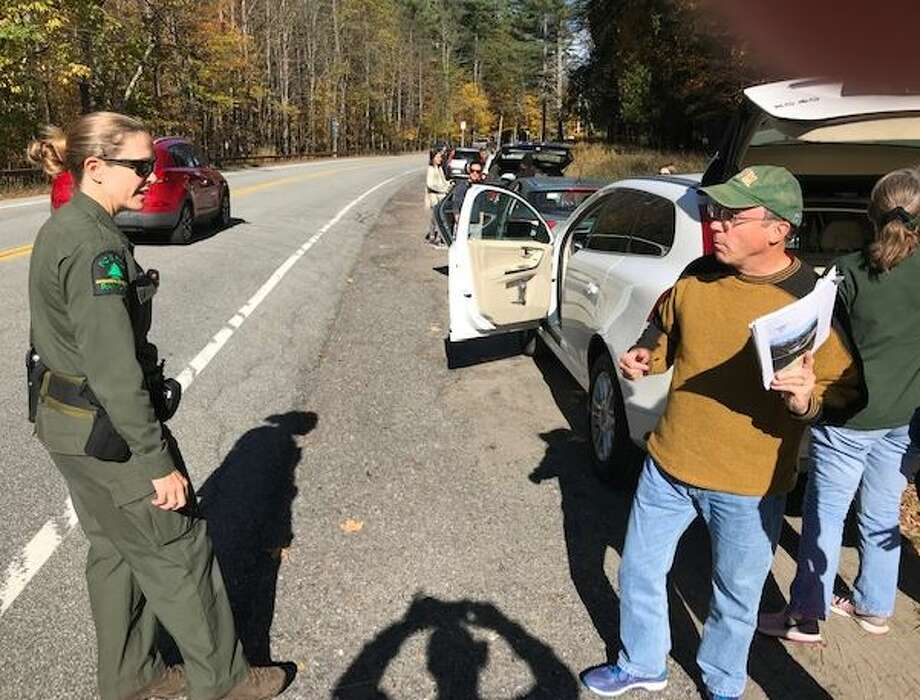 Forest Ranger Megan McCone explains that parking is prohibited in many spots in the Adirondack High Peaks area. Photo: Rick Karlin/Times Union
