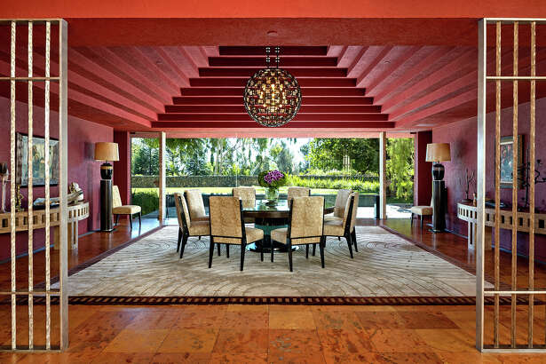 Blockbuster filmmaker Joel Silver has listed his Brentwood home for sale at $77.5 million. The Mexican modernist residence was designed by architect Ricardo Legorreta and completed in the early 2000s. Features of the 26,000-square-foot house include a circular atrium and a grand dining room with a pyramid-like ceiling. (Tyler Hogan)