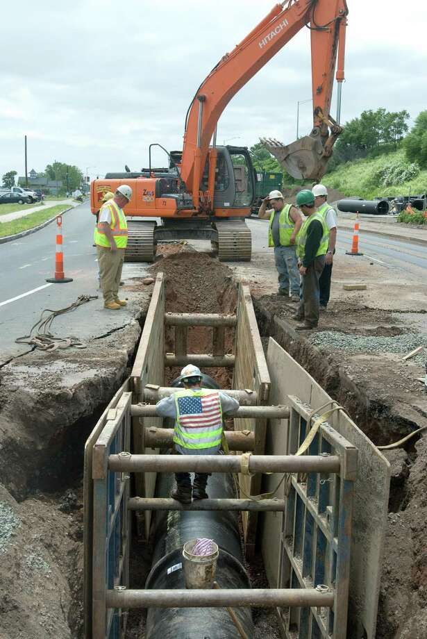 Workers from the South Central Connecticut Regional Water Authority work on installing a 36-inch water-main pipe along Long Wharf in New Haven. Photo: File Photo