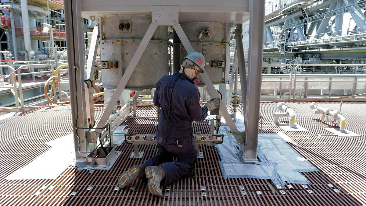 An employee working on a deepwater platform. The oil and gas industry is cutting jobs in Texas.
