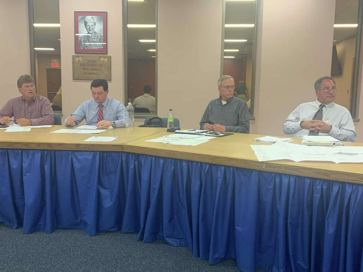 Members of the Derby Planning and Zoning commission discuss revising text in their Planned Development District lot size requirement this week to allow Derby Downtown LLC to build on Factory Street. Ted Estwan, Jr., the chairman is on the far left and next to him is former Trumbull First Selectman Tim Herbst, who is one of their lawyers.