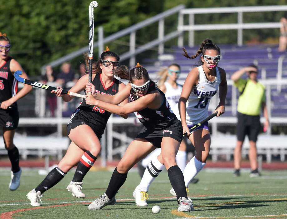 New Canaan's Marlee Smith lines up a shot during a field hockey game at Westhill High School in Stamford on Thursday, Sept. 19, 2019. Photo: Dave Stewart / Hearst Connecticut Media / Hearst Connecticut Media