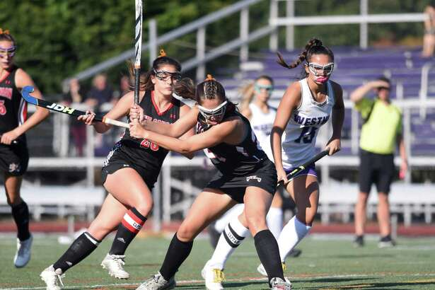New Canaan's Marlee Smith lines up a shot during a field hockey game at Westhill High School in Stamford on Thursday, Sept. 19, 2019.