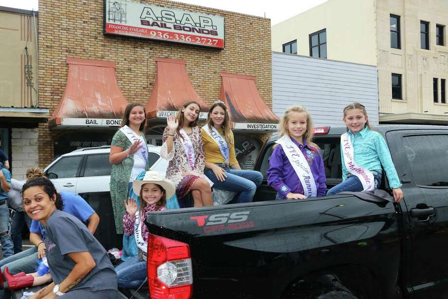 Main Street in Liberty was transformed into a parade of horses, decorated cars, and floats as the county celebrated the opening of the Trinity Valley Exposition. Photo: David Taylor / Staff Photo