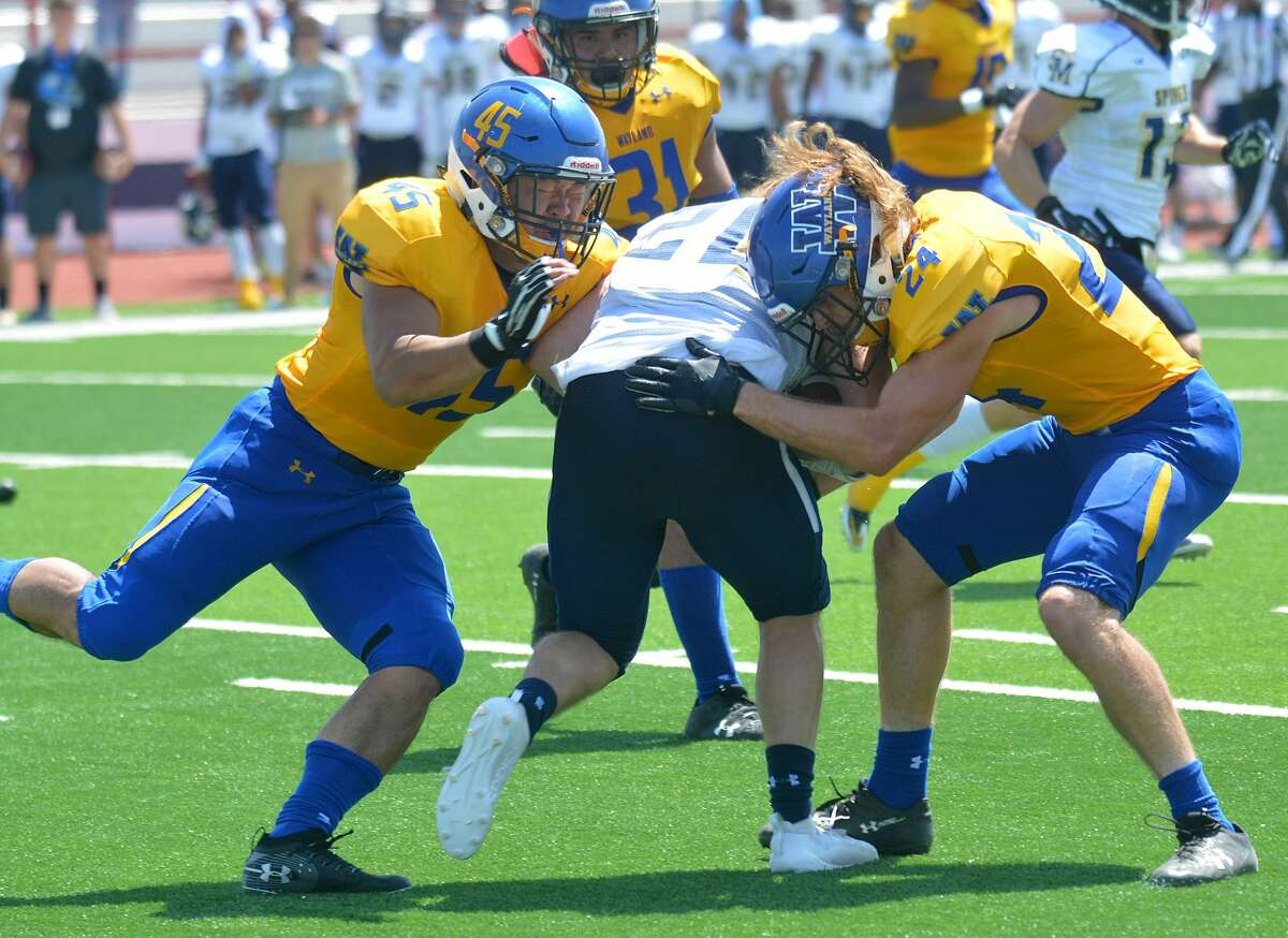 Wayland Baptist defenders Prince Kim (45) and Kaleb Thornton try to tackle the Saint Mary ball carrier during the Pioneers' season opener earlier this season.