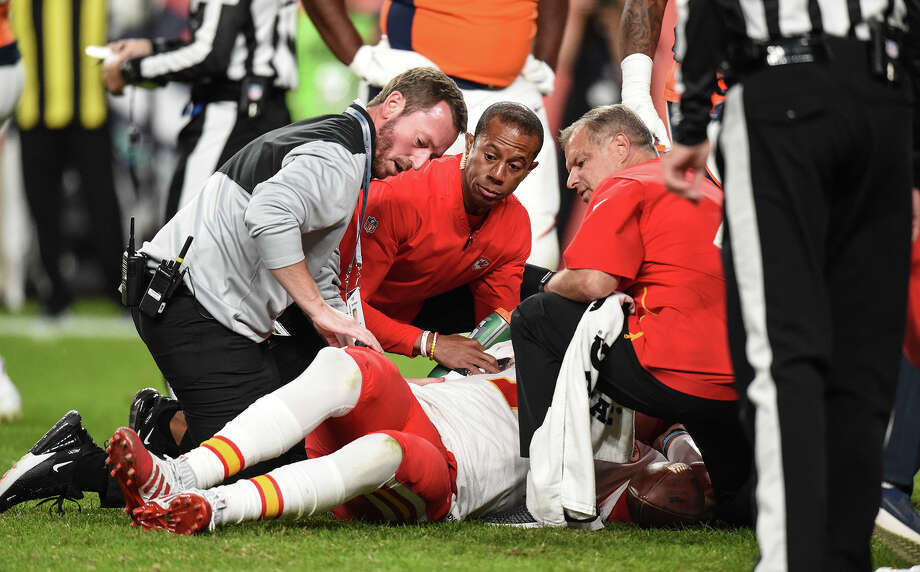 Kansas City Chiefs trainers attend to quarterback Patrick Mahomes after he injured his knee in the second quarter against the Denver Broncos on Thursday, Oct. 17, 2019, at Empower Field at Mile High in Denver. Photo: Tammy Ljungblad, TNS / Kansas City Star