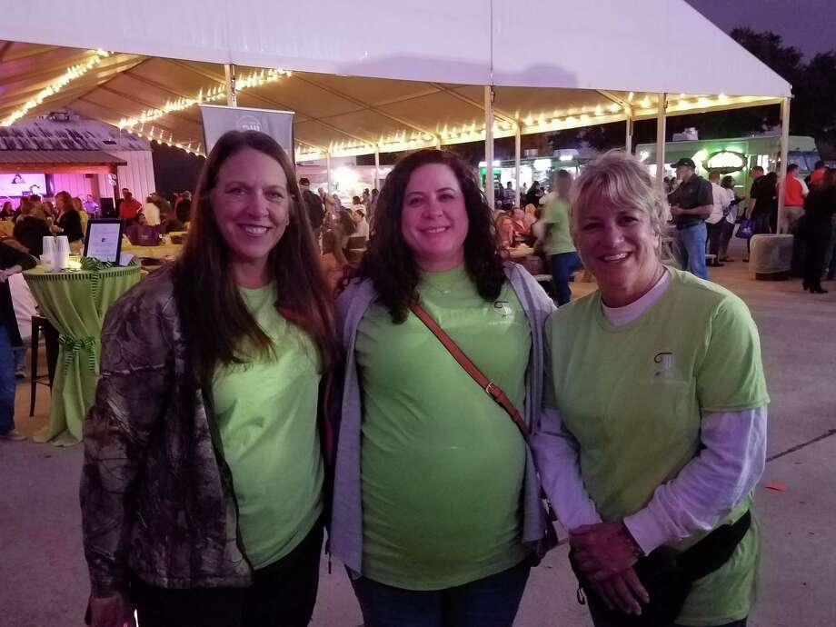 From left: Mary Ann Miron, Courtney Gonzales and Rhonda Burroughs were honored at the Katy ISD Education Foundation's Fireflies and Foodtrucks for being grant recipients Photo: Claire Goodman / Staff Photo