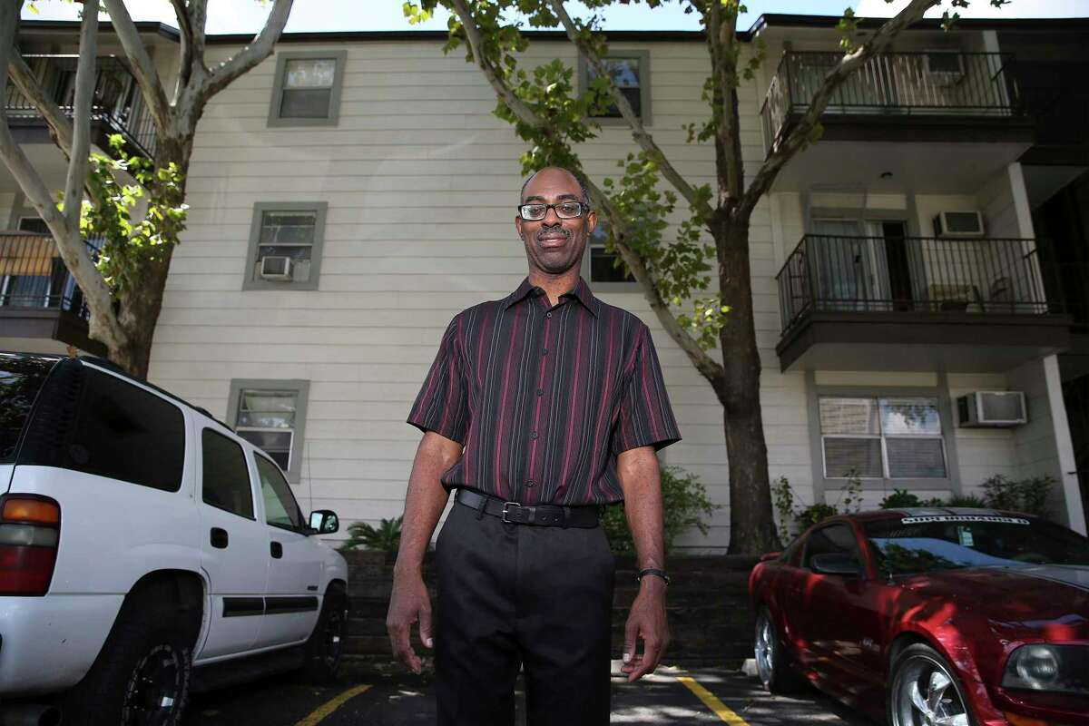 Michael Washington, 48, has lived at the Soap Factory apartment complex at 500 N. Santa Rosa St. for more than a decade. The property's Houston-based owners have been raising residents' rents since they bought the complex in 2017. Washington said he can afford the increases for now but that rising rents will probably force him out within the next two to three years. (Kin Man Hui/San Antonio Express-News)