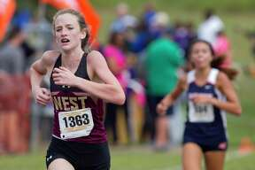 Magnolia West senior Peyton McQuillan won the District 19-5A cross country title on Thursday, helping the Lady Mustangs advance to the regional meet.