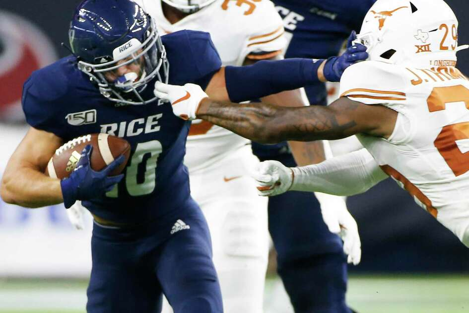 Texas Longhorns defensive back Josh Thompson (29) gets a piece of Rice Owls wide receiver Austin Trammell (10) facemask in the second half of game action at NRG Stadium in Houston on Saturday, Sept. 14, 2019. Texas Longhorns won the game 48-13.