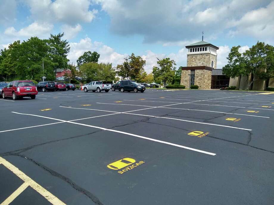 Pictured is when there were 60 spots for commuters, and other people to use the Boxcar app to park in when going to, and from work from the New Canaan train station. 60 Boxcar spots ready to go at St. Aloysius. Picture sent by Boxcar CEO Joe Colangelo. Photo: Boxcar CEO Joe Colangelo / Contributed Photo / New Canaan News contributed