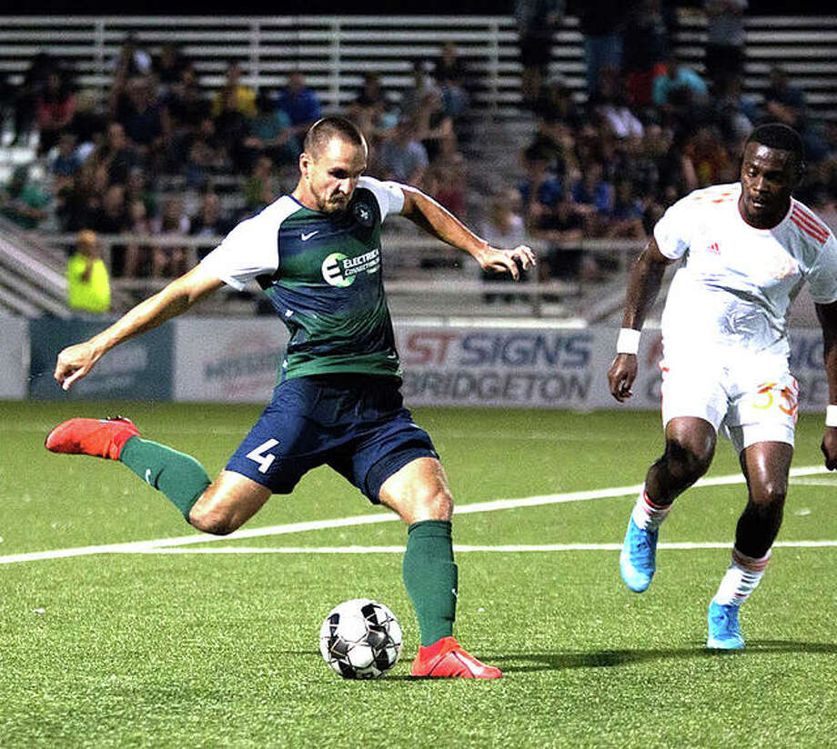 St. Louis FC defender Sam Fink, left, takes a shot during a game this season. Fink is a former soccer standout at Edwardsville High School. Photo: Will Bramlett/STLFC