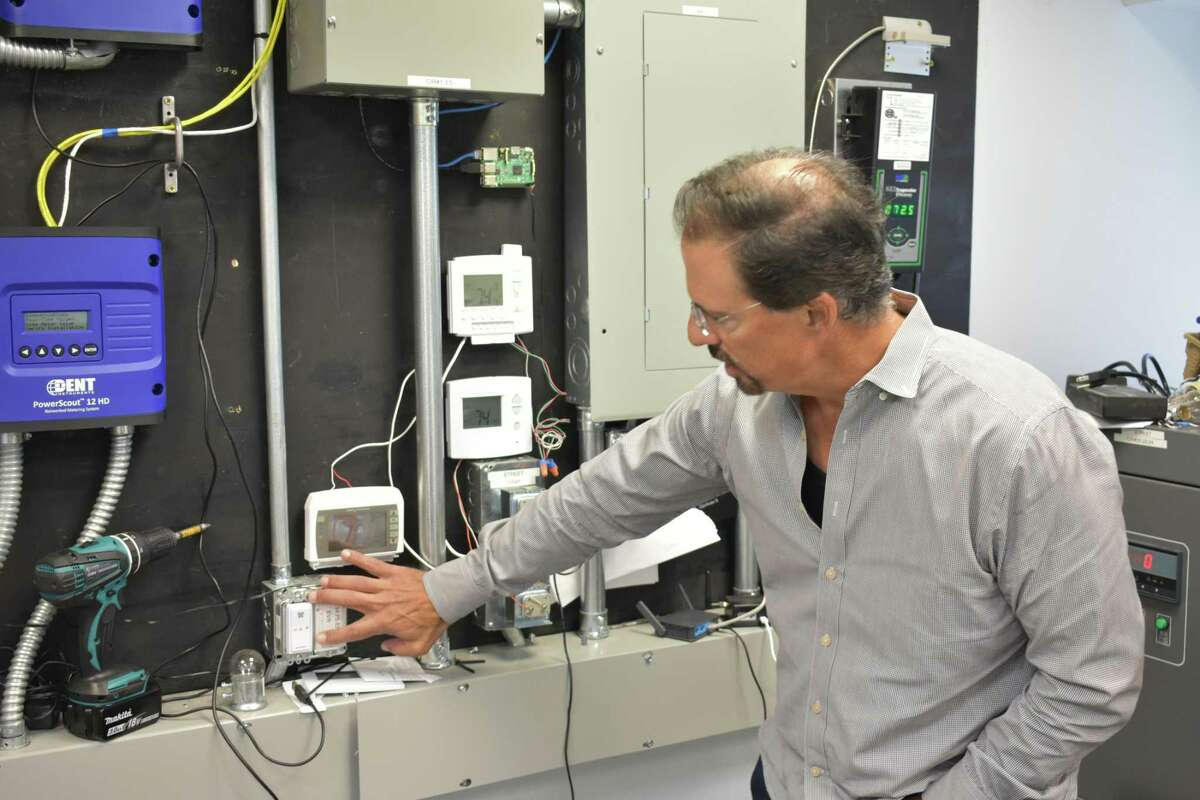 Budderfly CEO Al Subbloie shows systems the startup is testing at its Shelton, Conn. headquarters to monitor energy use in buildings. Budderfly takes over utility bill payments for its commercial customers, guaranteeing savings and taking a percentage of those savings as its own revenue stream.