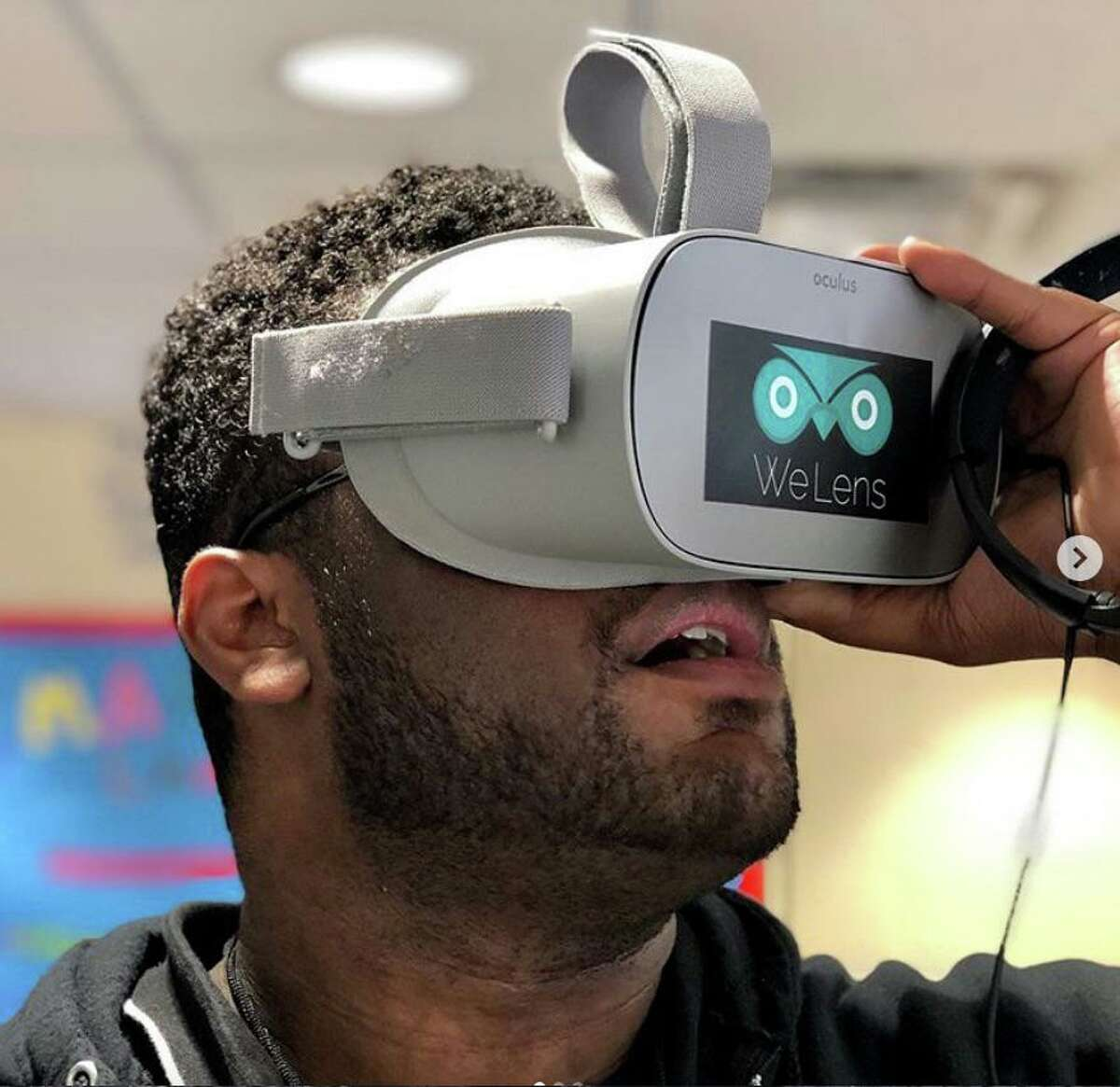 A Ridgefield Independent Film Festival attendee tries on a virtual reality headset.