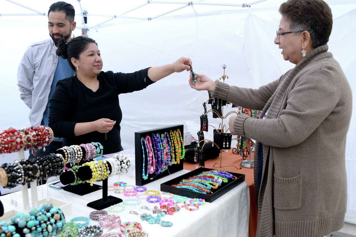 Amid the COVID-19 pandemic, the Katy Rice Festival is going virtual, slated for Friday, Oct. 9, through Sunday, Oct. 11. Here, an attendee shops for jewelry at the event on October 12, 2019.