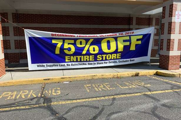 A banner posted outside one of the entrance doors to the Big Y Supermarket in Ansonia announces their final 75 percent off sale which began Friday.