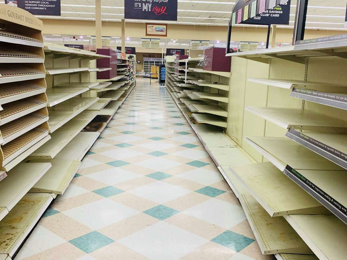 Barren shelves are common Friday in the Ansonia Big Y Supermarket with the store's 75 percent off closing sale.