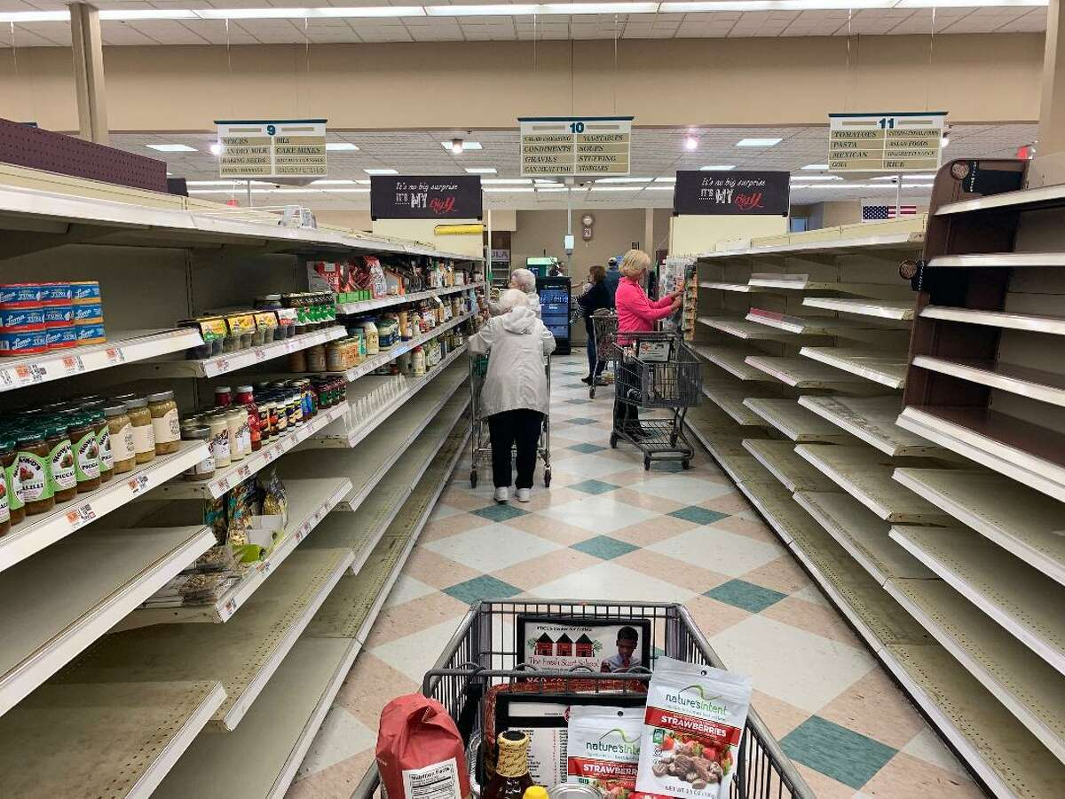 Shoppers look for bargains in the final 75 percent off sale at the Big Y Supermarket in Ansonia Friday. The store will close for good on Saturday.