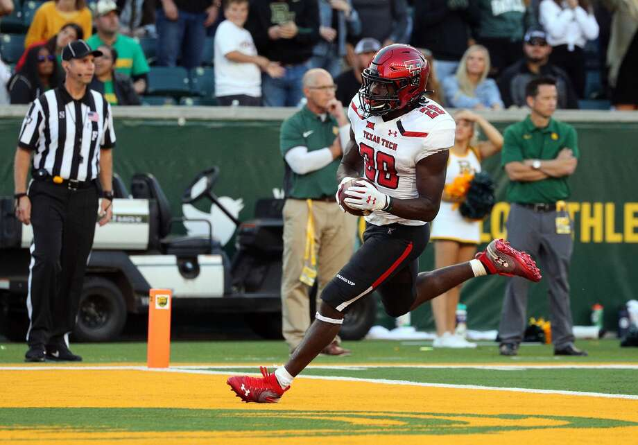 WACO, TEXAS - OCTOBER 12: SaRodorick Thompson #28 of the Texas Tech Red Raiders scores a touchdown in the fourth quarter against the Baylor Bears on October 12, 2019 in Waco, Texas. (Photo by Richard Rodriguez/Getty Images) Photo: Richard Rodriguez/Getty Images
