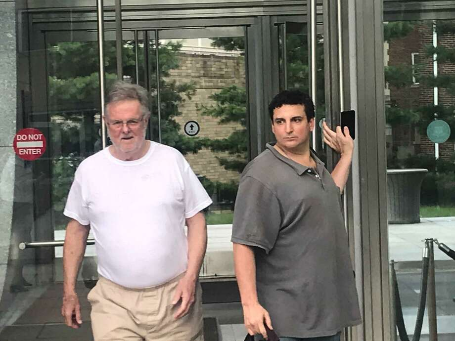 Family law attorney Ridgely Brown, 72, walking out of the Stamford courthouse with his bondsman, Jonny Barber, and a female employee after posting a $500,000 bond and being released from jail. Photo: John Nickerson / Staff