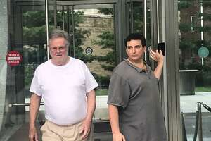 Family law attorney Ridgely Brown, 72, walking out of the Stamford courthouse with his bondsman, Jonny Barber, and a female employee after posting a $500,000 bond and being released from jail.