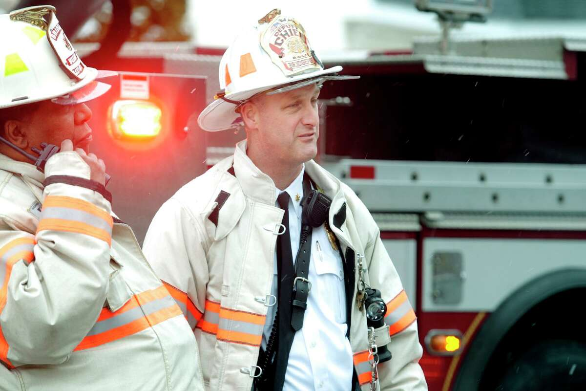 FILE PHOTO: Deputy Fire Chief Ron Rolfe of the Bridgeport Fire Department at the scene of a fire in an unoccupied home on Hanover St. in Bridgeport, Conn. March 21, 2018.