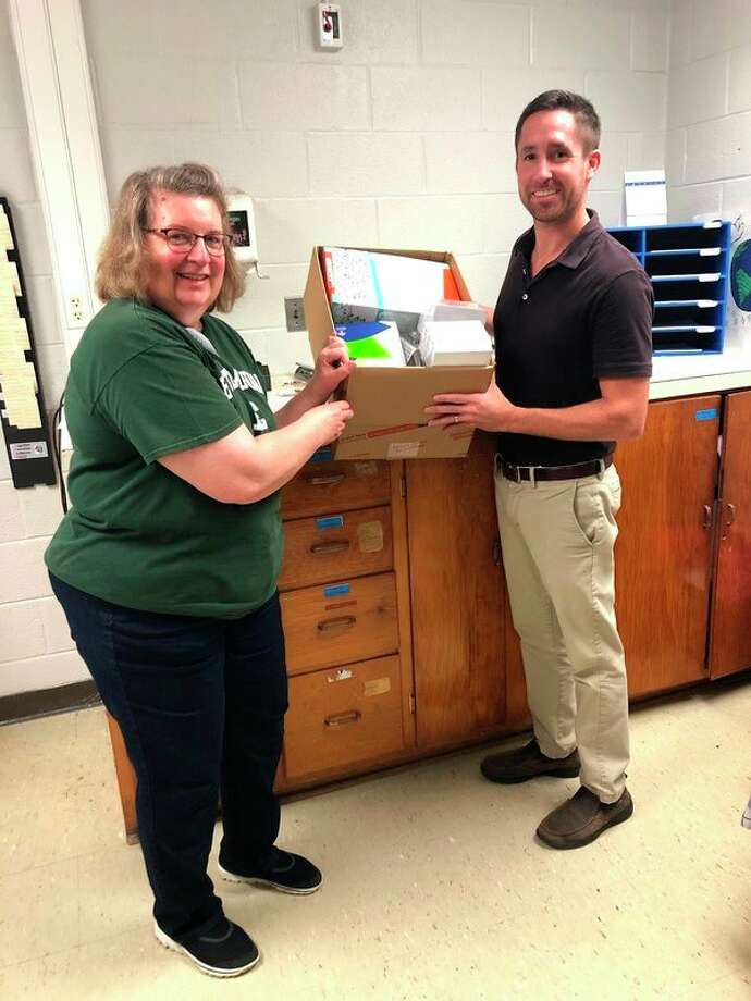 Connie Sutter-Roemer, an Owen-Gage teacher, receives a Back to School Supply Kit Grant from Dan Gentner from Gentner Insurance. (Submitted Photo)