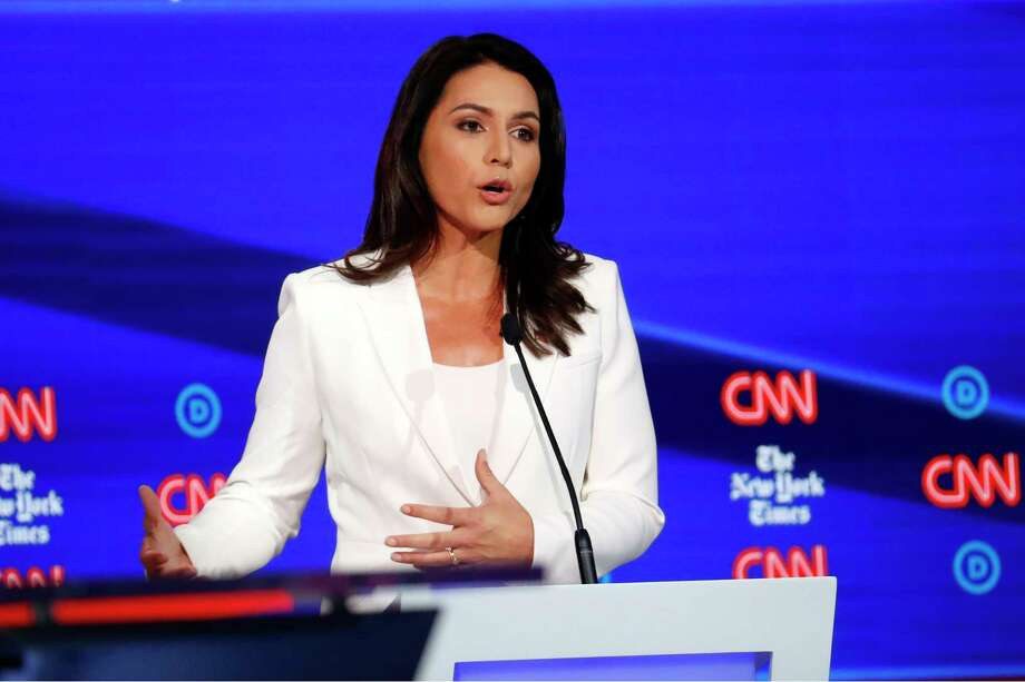 Democratic presidential candidate Rep. Tulsi Gabbard, D-Hawaii, participates in a Democratic presidential primary debate hosted by CNN/New York Times at Otterbein University, Tuesday, Oct. 15, 2019, in Westerville, Ohio. Photo: John Minchillo, AP / Copyright 2019 The Associated Press. All rights reserved