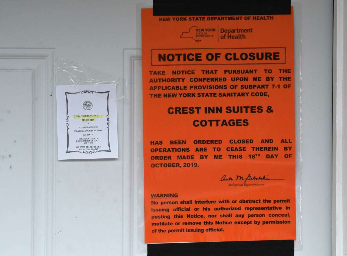 State Health Department closure notices are placed on doors at the Crest Inn on Friday, Oct. 18, 2019, in Wilton, N.Y. The property is owned by the Hussain family, who also operated the limousine involved in the deadly Schoharie crash. Nauman Hussain, 29, and his family were trying to sell the motel for $1 million. (Will Waldron/Times Union)