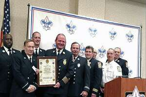 Bridgeport, Conn., Fire Chief Richard Thode (holding the plaque) was awarded for his service and leadership to the city.