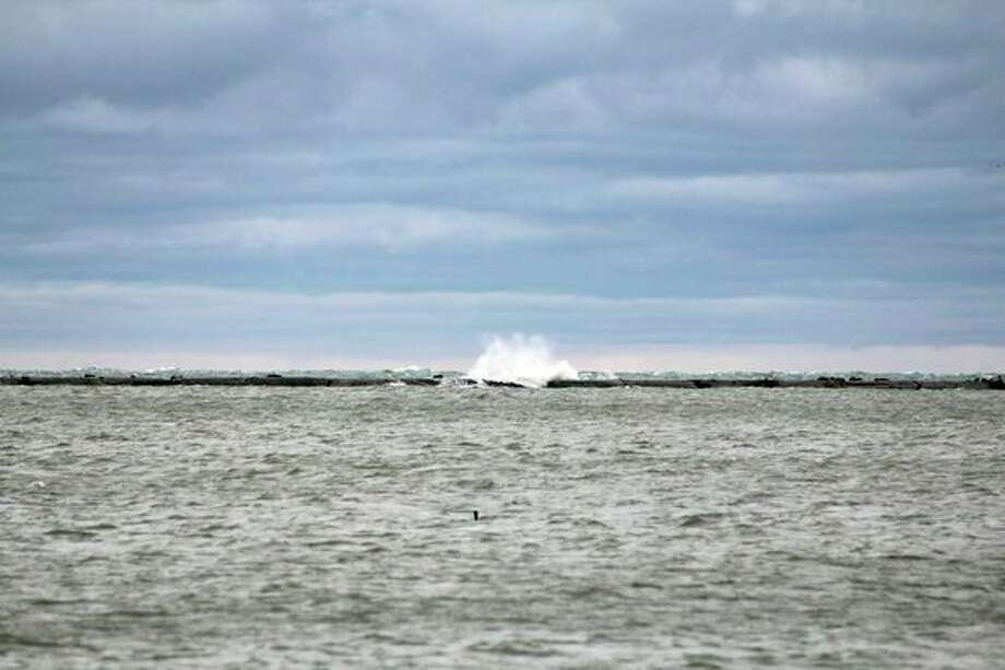 Large waves were recently spotted smashing into the breakwall in Harbor Beach. The National Weather Service has issued a lakeshore flood warning for Huron County. (Scott Nunn/Huron Daily Tribune)