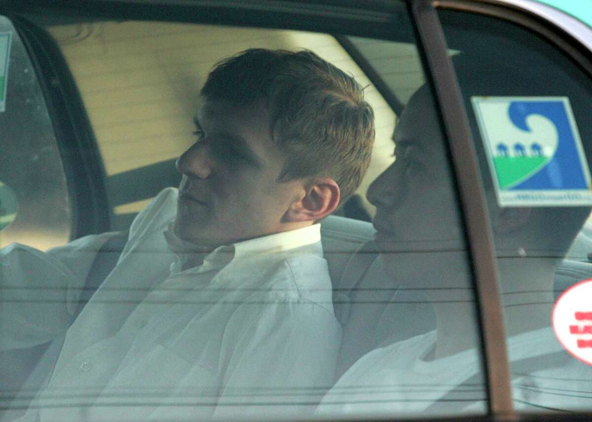 James O'Keefe, left, and Stan Dai leave the St. Bernard Parish jail a taxi cab in Chalmette, La., Tuesday, Jan. 26, 2010. O'Keefe, a conservative activist who posed as a pimp to target the community-organizing group ACORN, was one of four people arrested by the FBI and accused of trying to interfere with phones at Sen. Mary Landrieu's office in New Orleans.