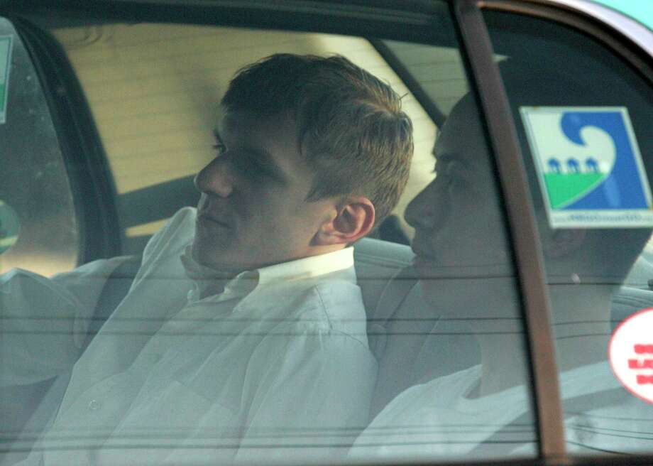 James O'Keefe, left, and Stan Dai leave the St. Bernard Parish jail a taxi cab in Chalmette, La., Tuesday, Jan. 26, 2010. O'Keefe, a conservative activist who posed as a pimp to target the community-organizing group ACORN, was one of four people arrested by the FBI and accused of trying to interfere with phones at Sen. Mary Landrieu's office in New Orleans. Photo: Patrick Semansky / AP / AP2010