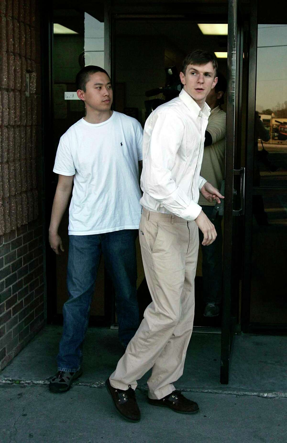Stan Dai, left, and James O'Keefe walk out of the St. Bernard Parish jail in Chalmette, La., Tuesday, Jan. 26, 2010.
