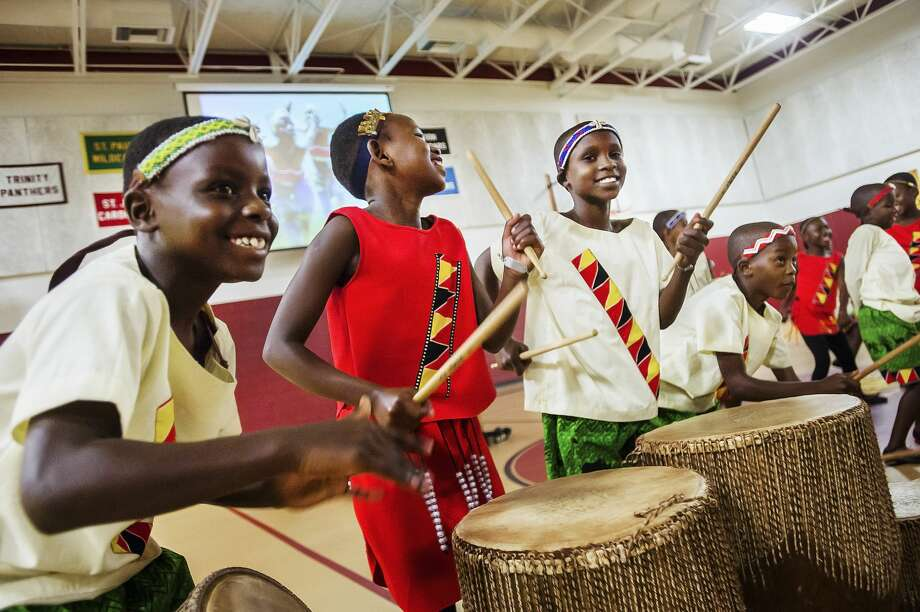 Members of the African Children's Choir perform for an audience of faculty and students at St. John's Lutheran School Friday, Oct. 18, 2019 in Midland. (Katy Kildee/kkildee@mdn.net) Photo: (Katy Kildee/kkildee@mdn.net)